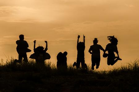 people shadow: People jumping siluate photo, sunrise photo of friendship