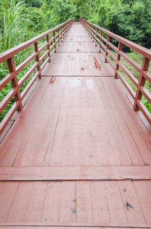 scrub grass: Wooden bridge in golf course lake in Andalusia