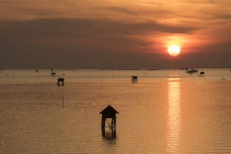 fishing cabin: Fishermens cottages Cabin In The Sea sunset for fishing in the ocean, Thailand