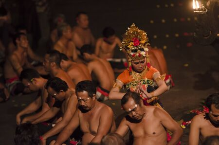 chant: BALI, INDONESIA - JUNE 14: Presentation of traditional balinese Women Kecak Fire Dance on JUNE 14, 2015 on Bali. Kecak (also known as Ramayana Monkey Chant) is very popular cultural show on Bali.