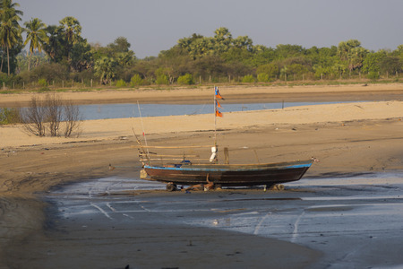 aground: The ship ran aground on the beach after the storm, Burma