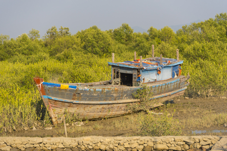 beached: The boat  ran aground on the beach after the storm, Burma Stock Photo