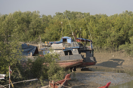vessel sink: The boat ran aground on the beach after the storm, Burma