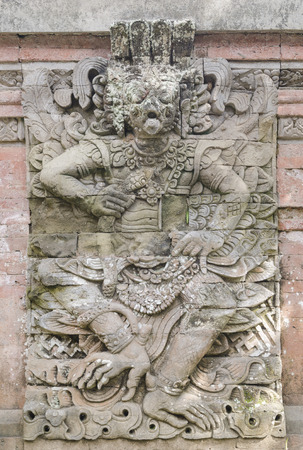 offerings: Statues of Hindu God or demons with offerings, Bali, Indonesia