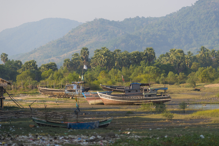 aground: The boat ran aground on the beach after the storm, Burma