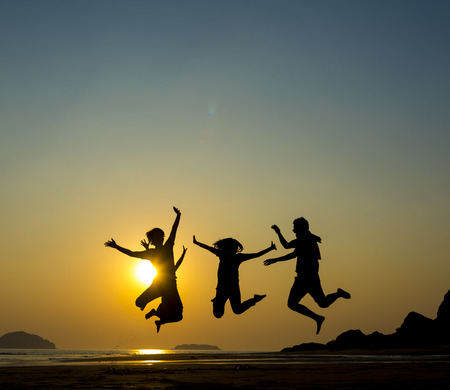 glowworm: Happy family, father, mother, son and daughter in nature, sunset Stock Photo
