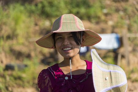 thanaka: INWA,MYANMAR-October 12 : Myanmar woman with thanaka on her smile face is happiness on October 12,2015 in Inwa city,Middle of Myanmar.Thanaka is a yellowish-white cosmetic paste made from ground bark.