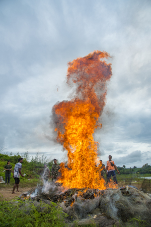 illegality: Kanchanaburi, Thailand - SEPTEMBER 15, 2015: Fire Burning of illegality. Volunteers are helping to set fire to destroy drugs in Kanchanaburi on SEPTEMBER 15, 2015