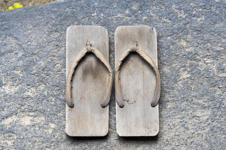 ryokan: Onsen series : Two pair of wooden sandals on wooden floor Stock Photo