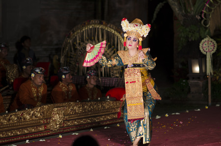 local 27: BALI, INDONESIA SEPTEMBER 27, 2015: Traditional dance Legong and Barong is performed by local professional actors in Ubud Palace