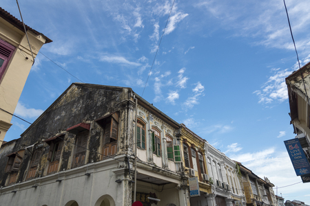 louvered: Georgetown, Penang, Malaysia - JULY 5, 2015 Traditional Malaysian colonial houses on a street in Georgetown Editorial