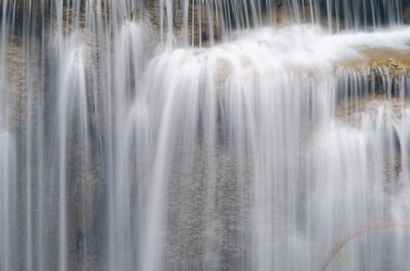 Erawan Waterfall, beautiful waterfall with sunlight rays in deep forest, Erawan National Park in Kanchanaburi, Thailand Imagens