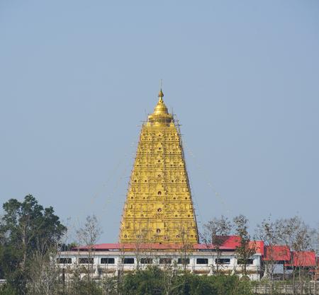 bodhgaya: Buddha on Chedi Buddhakhaya, built to mimic the Mahabodhi stupa of Bodhgaya in India, a symbol of Sangklaburi, Kanchanaburi, Thailand