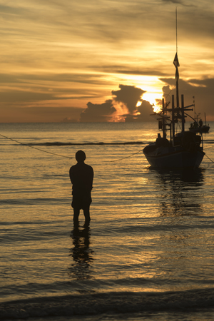 sea sunset with fishing boat Stock Photo