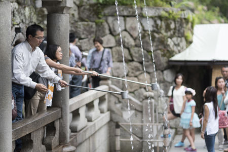 dera: Kyoto, JAPAN-JANUARY 13: Tourist at Kiyomizu-dera Temple in Kyoto Japan on January 13,2016 Kiyomizu-dera was founded in the early Heian period. Editorial