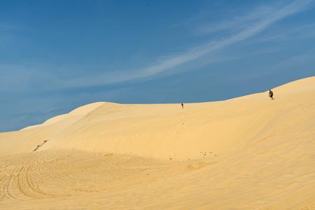 ne: White sand dunes with blue skies, Mui Ne, Vietnam