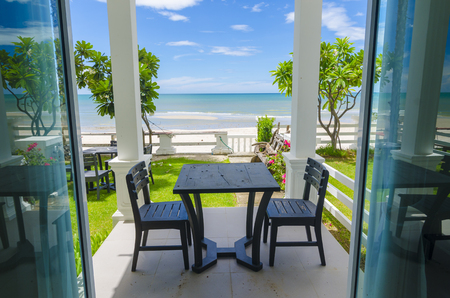 Terrace sea view with outdoor wood chairs and table