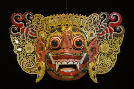 balinese: Traditional Balinese mask on a black background.