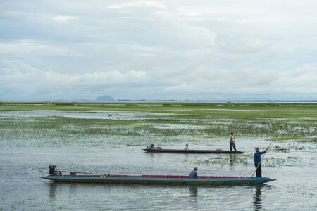 alappuzha: SONGKLA, THAILAND -MARCH 13 : Unidentified villagers in a boat do fishing in the waters on MARCH 3, 2016 in Songkla, Thailand. Fishing is a major activity of people living in the backwater region