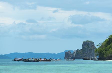 KRABI,THAILAND - April 14, 2017: Tourists enjoying the beautiful miracle beach & crystal clear water at Koh Kai, Koh Tub & Koh Mor, Krabi, Thaiand