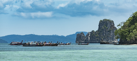 KRABI,THAILAND - MAY 6, 2017: Tourists enjoying the beautiful miracle beach & crystal clear water at Koh Kai, Koh Tub & Koh Mor, Krabi, Thaiand Editorial