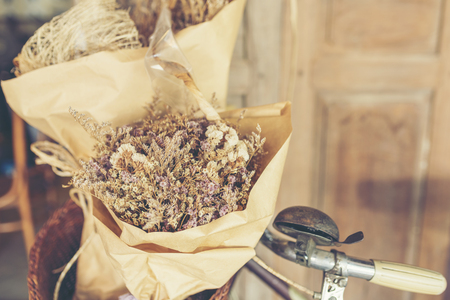 Bouquet of flowers on the old bicycle. Stock Photo