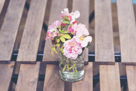 Beautiful flowers are arranged on the dinner table.