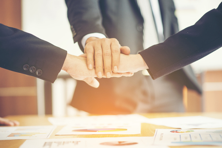 confident business man shaking hands during a meeting in the office, success, dealing, greeting and partner concept.