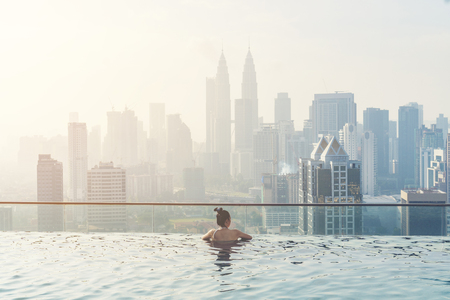 Swimming pool on roof top with beautiful city view kuala lumpur malaysia Stock Photo