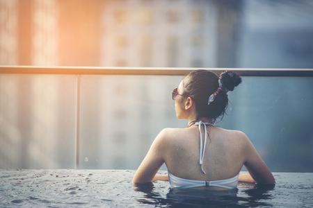 Swimming pool on roof top with beautiful city view kuala lumpur malaysia 写真素材