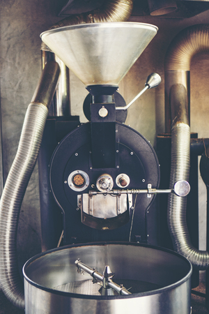 roasted coffee machine for Coffee beans roasting process 写真素材