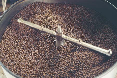 fresh coffee beans in roast machine, arabica roasted coffee ,vintage filter image