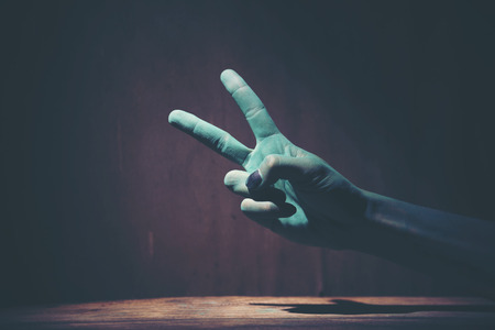 Green hand of the ghost on Halloween Stock Photo