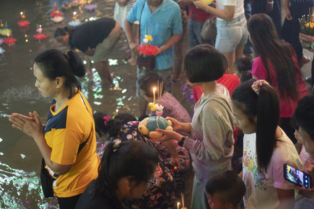 Bangkok, Thailand - November 22 2018 : Loy Krathong festival, People buy flowers and candle to light and float on water to celebrate the Loy Krathong festival in Thailand.