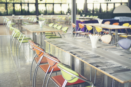 Tables and chairs empty in canteen Standard-Bild