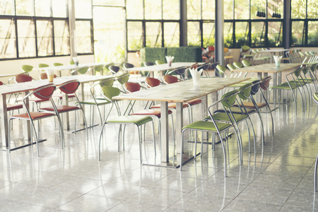 Tables and chairs empty in canteen Foto de archivo
