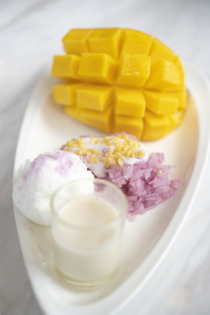 mango and sticky rice is popular traditional dessert of Thailand Banco de Imagens