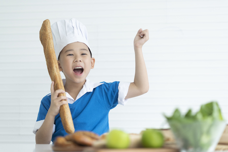 Kids chefs are enjoying cooking.