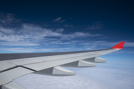 Plane wings and the sky View from the passenger window Reklamní fotografie