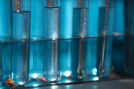 Test tube of glass overflows new liquid solution potassium blue conducts an analysis reaction takes various versions reagents using chemical pharmaceutics cancer manufacturing 免版税图像