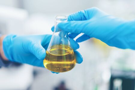 The scientist test the natural product extract, oil and biofuel solution, in the chemistry laboratory.