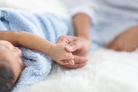Newborn baby sleeping in bed