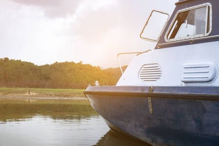 Inspection boat over the river, tropical lake Stock Photo