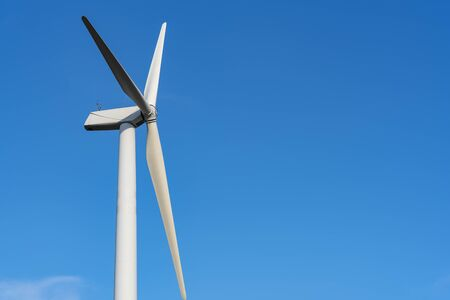 The wind turbine power working, blue sky, energy power concept