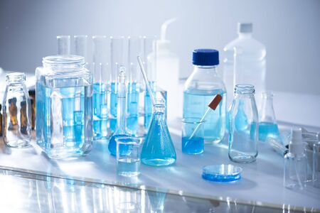 Chemical laboratory equipment Glassware for research and blue matter Foto de archivo
