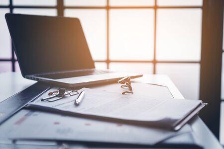 Business desktop with laptop, glasses, business schedule 免版税图像 - 126169816