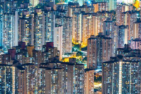 Hong Kong cityscape at night, sky scraper building Imagens