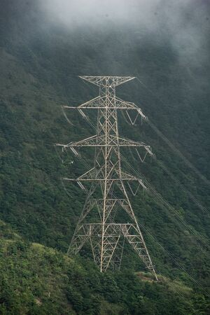 High voltage electric pole in the forest 写真素材