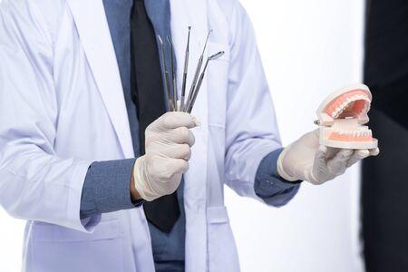 Dentist portraits and dental equipment, on white background