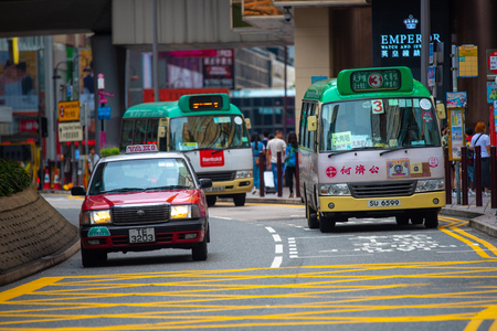 Hong Kong, China - August, 2019 : Taxi and traffic in Hong Kong, China Editöryel